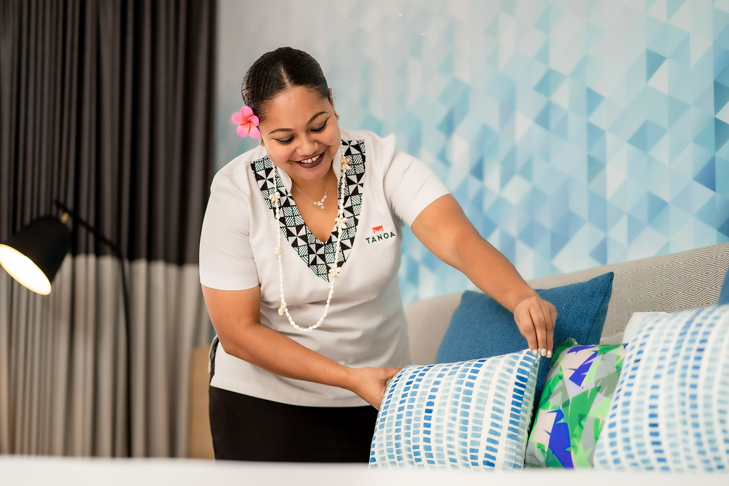 tanoaplaza_corporate_shoot_staff-fluffing-pillows3-web